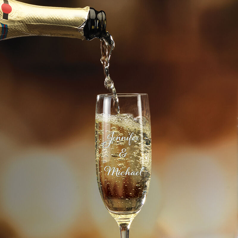 The Personalized Couples Champagne Flutes 10036 0049 c pouring champagne